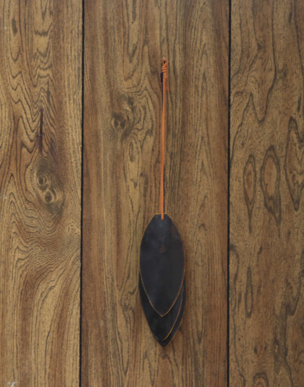 """Llewelyn Fletcher """"Feather shield (for LRAD) patinated steel, felt, leather, wax, copper nail. 2018."""