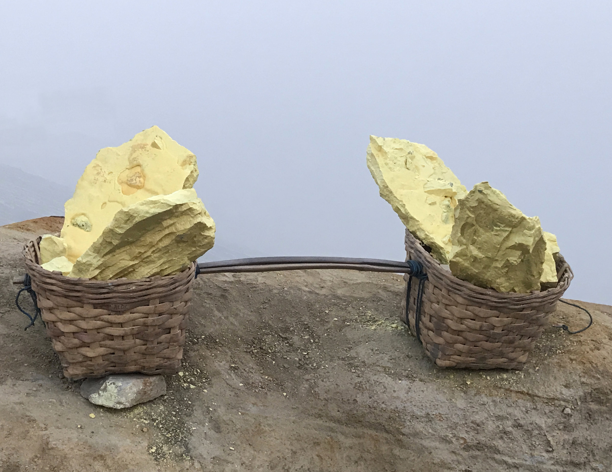 A miner's baskets, full of sulfur.