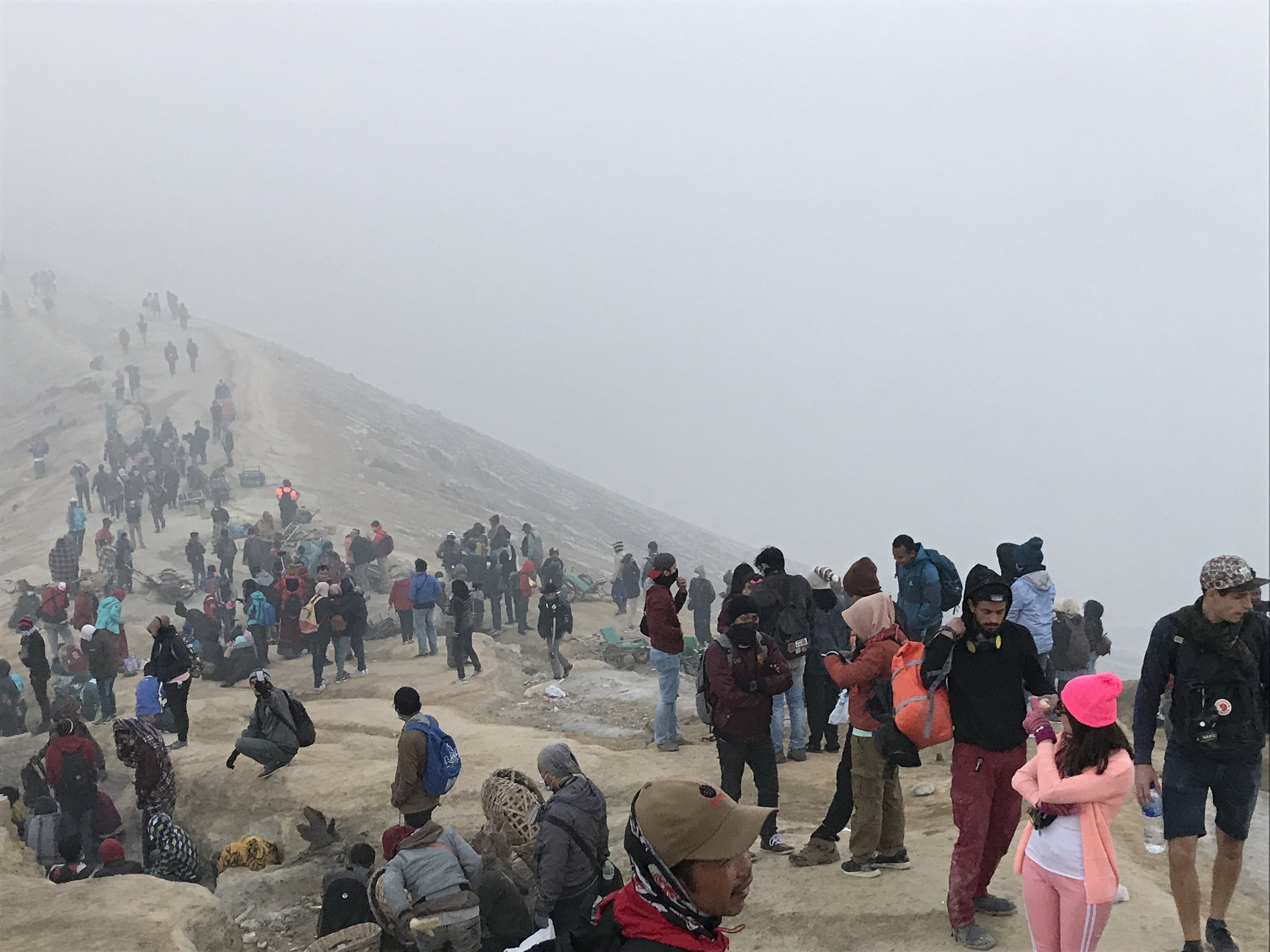 The crowds of people at the rim of the crater.