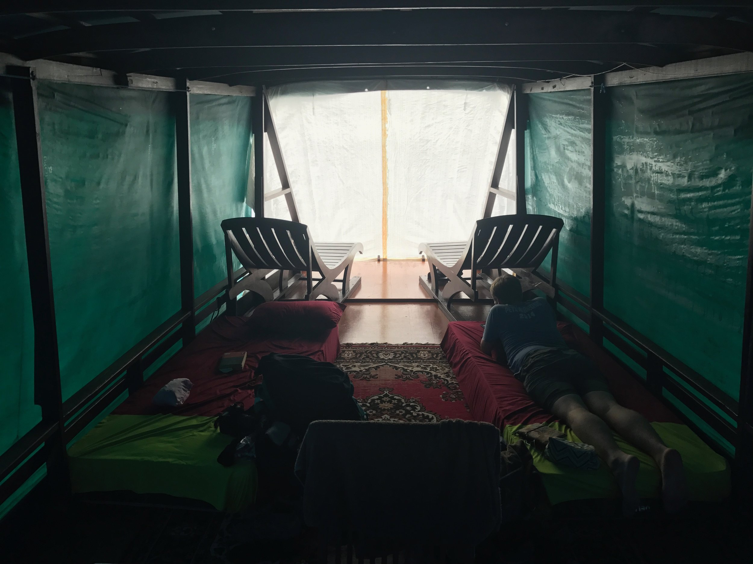 Inside our klotok during a downpour.