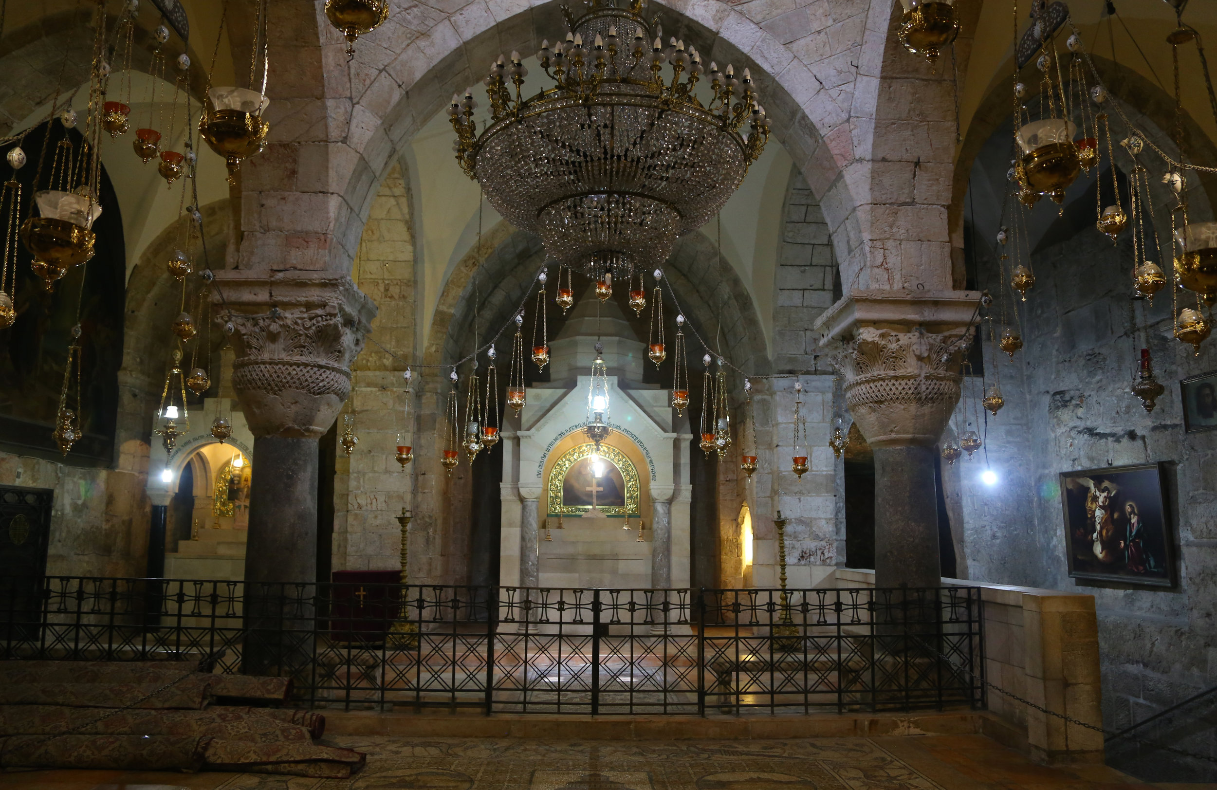 A quite moment inside the Chapel of Saint Helena at the Church of the Holy Sepulchre, built upon the site identified as the location of the crucifixion of Jesus.
