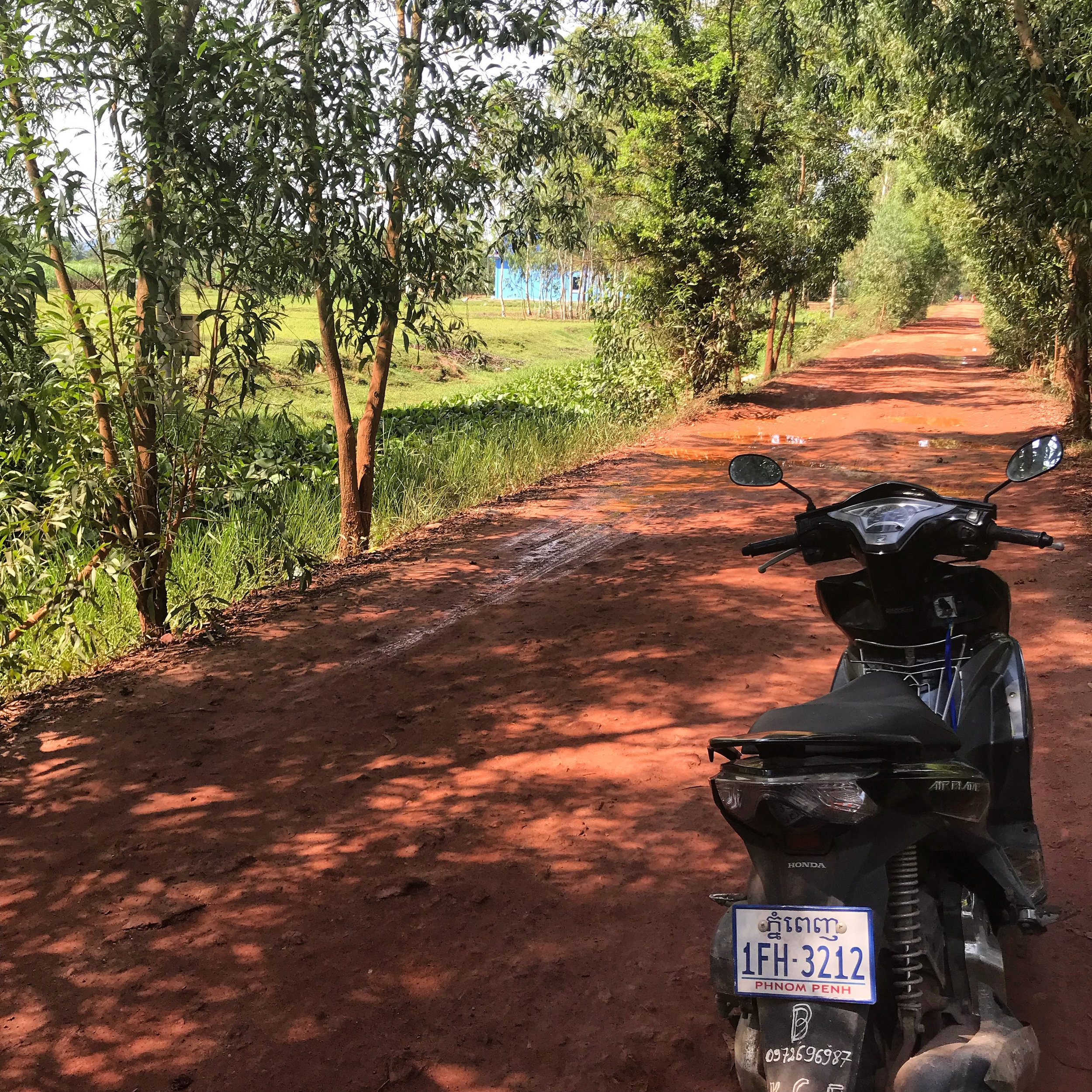 Stopping for a rest on a village road between Kep and Kampot.