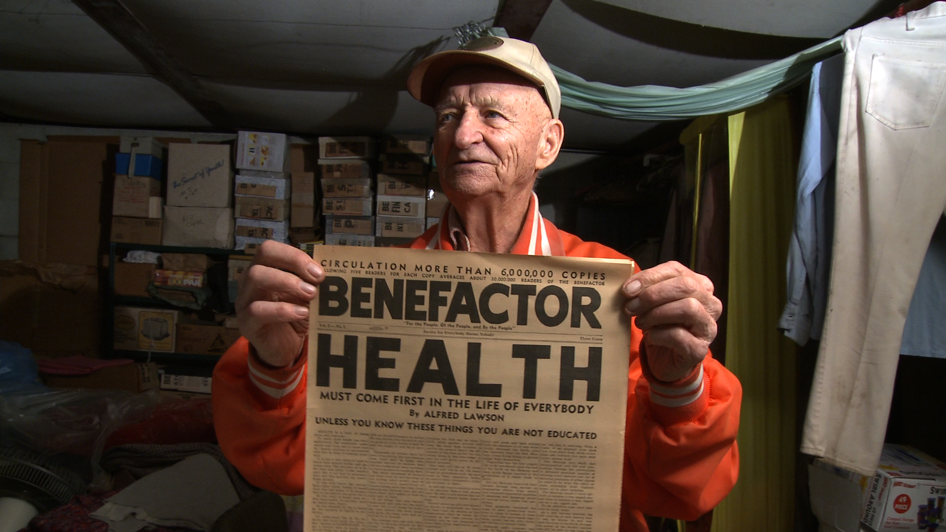 Merle holding an issue of Lawson's paper - The Benefactor