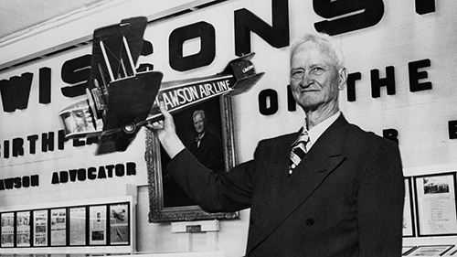 Alfred Lawson with model of his first airliner, photo taken at the Wisconsin Cenntenial in 1948.