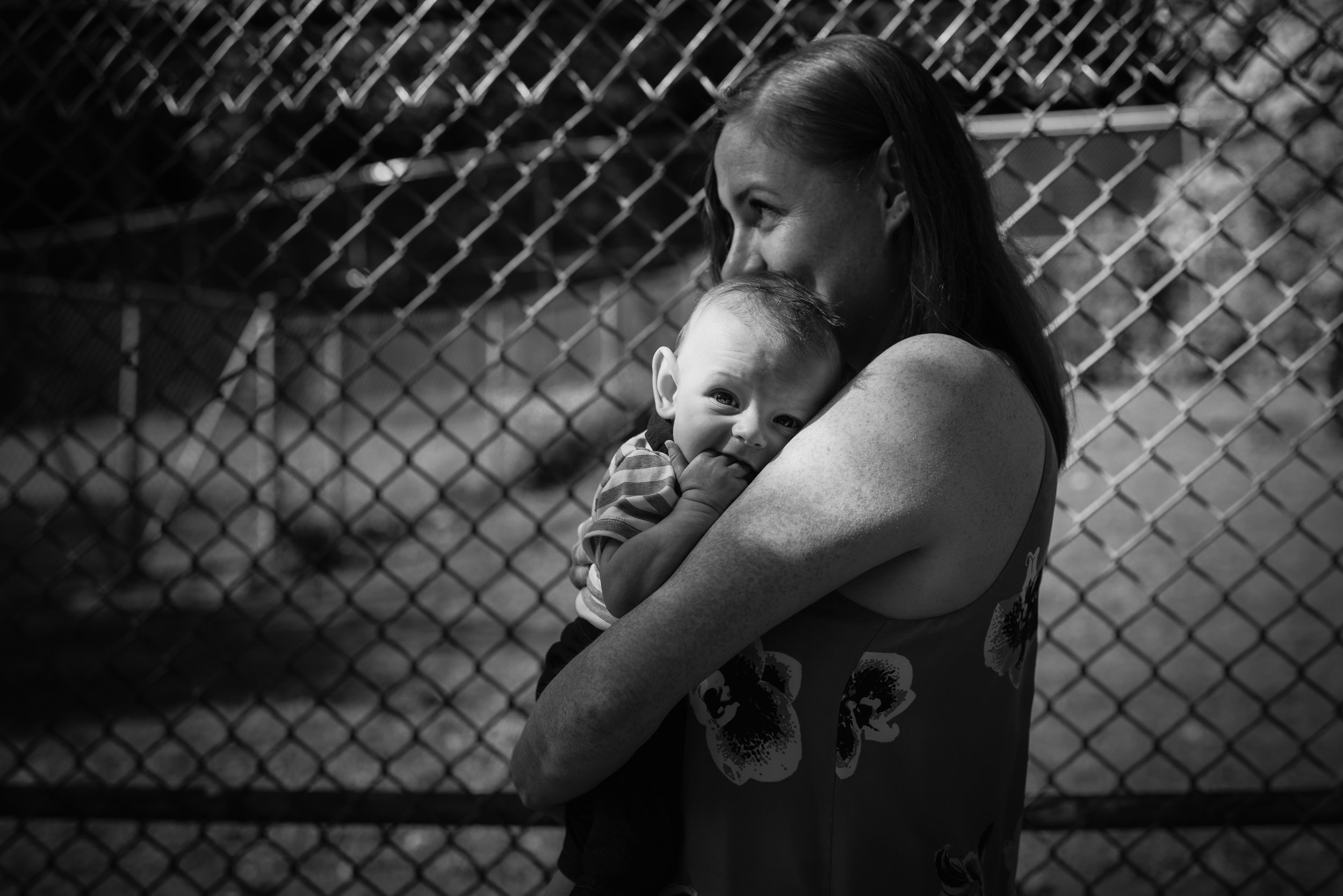 Fresh-faced little boy was all-too-happy in the arms of mommy (High Park, Toronto)