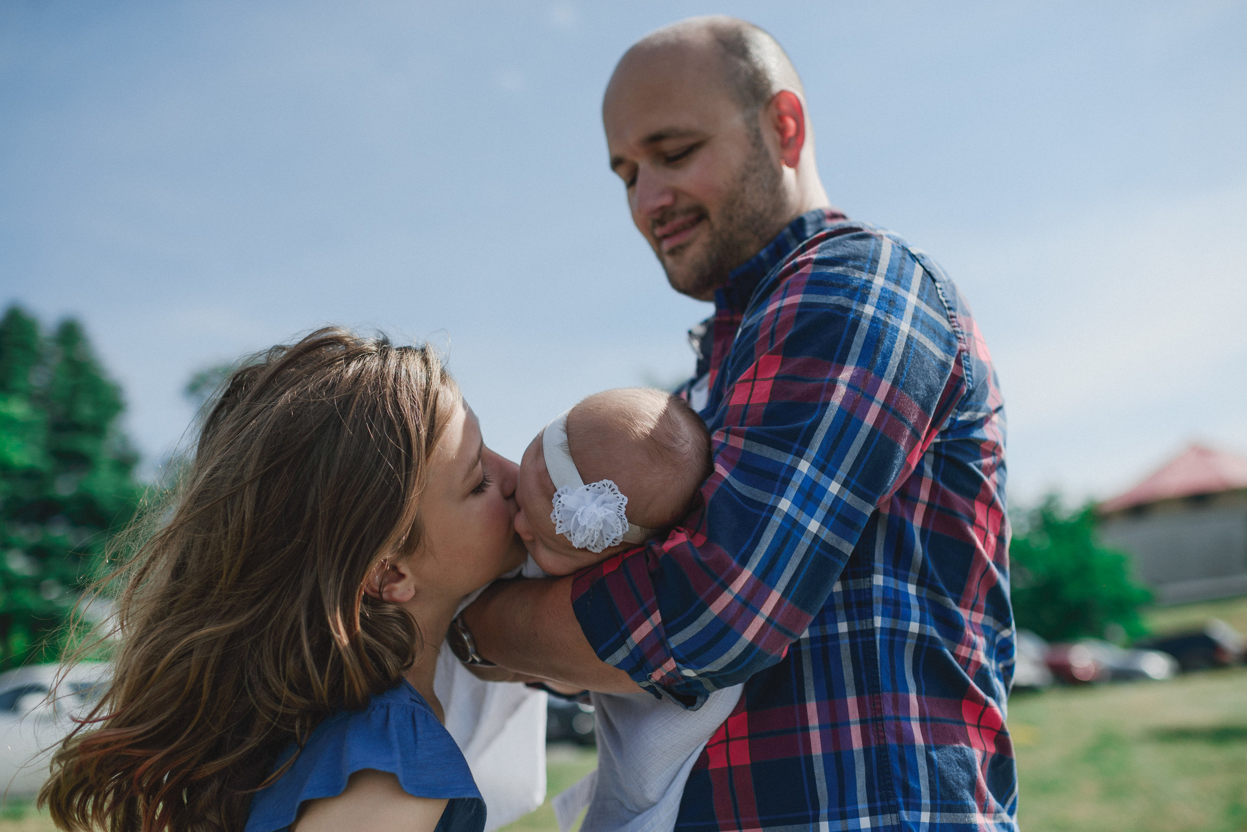 New baby sister gets endless kisses (City park, Kingston)