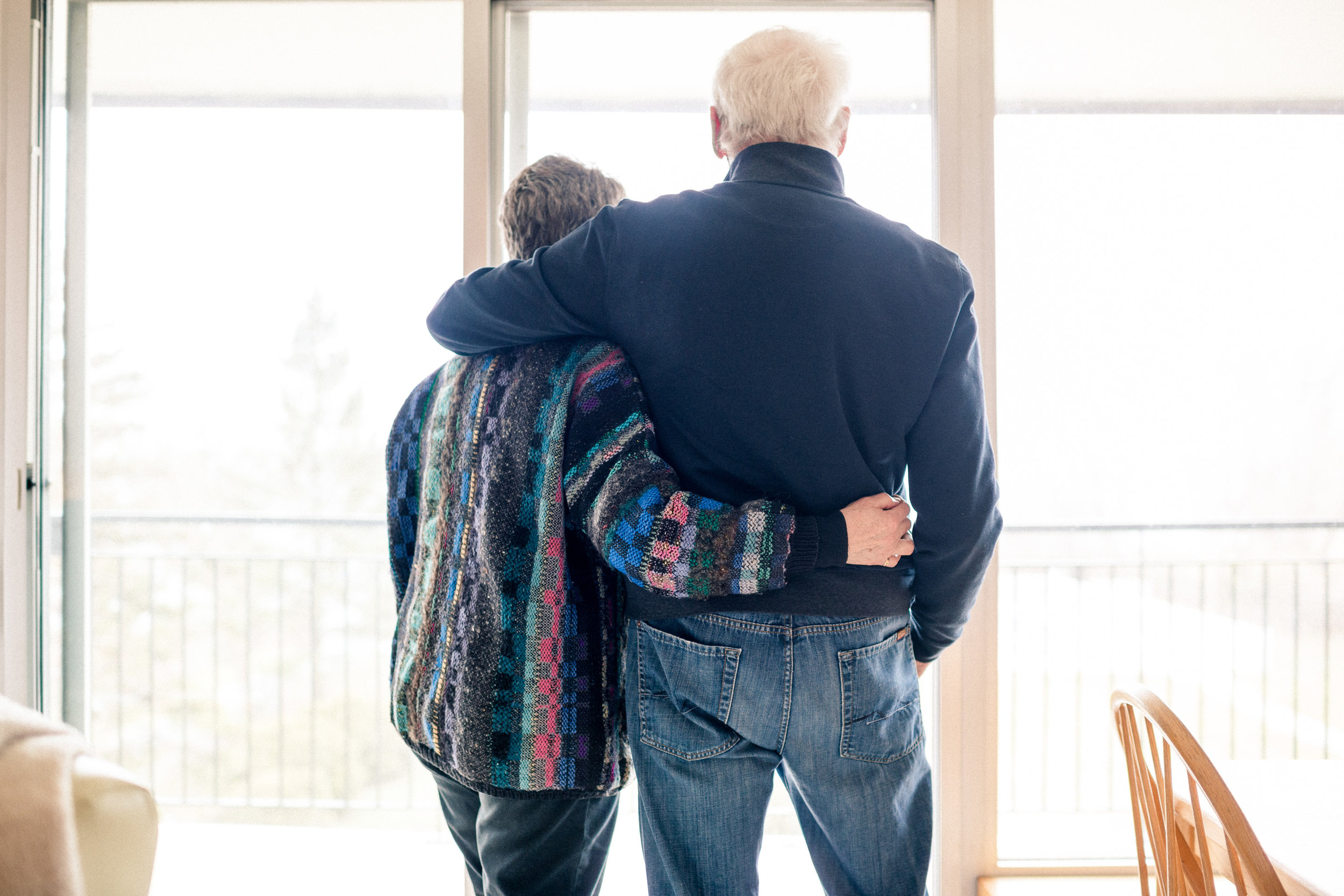 After 53 years together, they are still in love. Here they are, looking out toward the lake through the window of their condo, looking toward the bright future.
