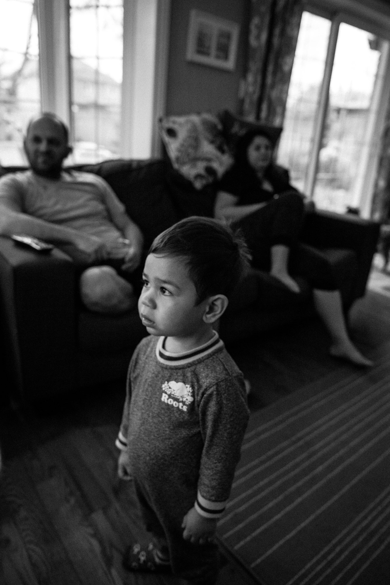 toddler stands in front of TV and watches