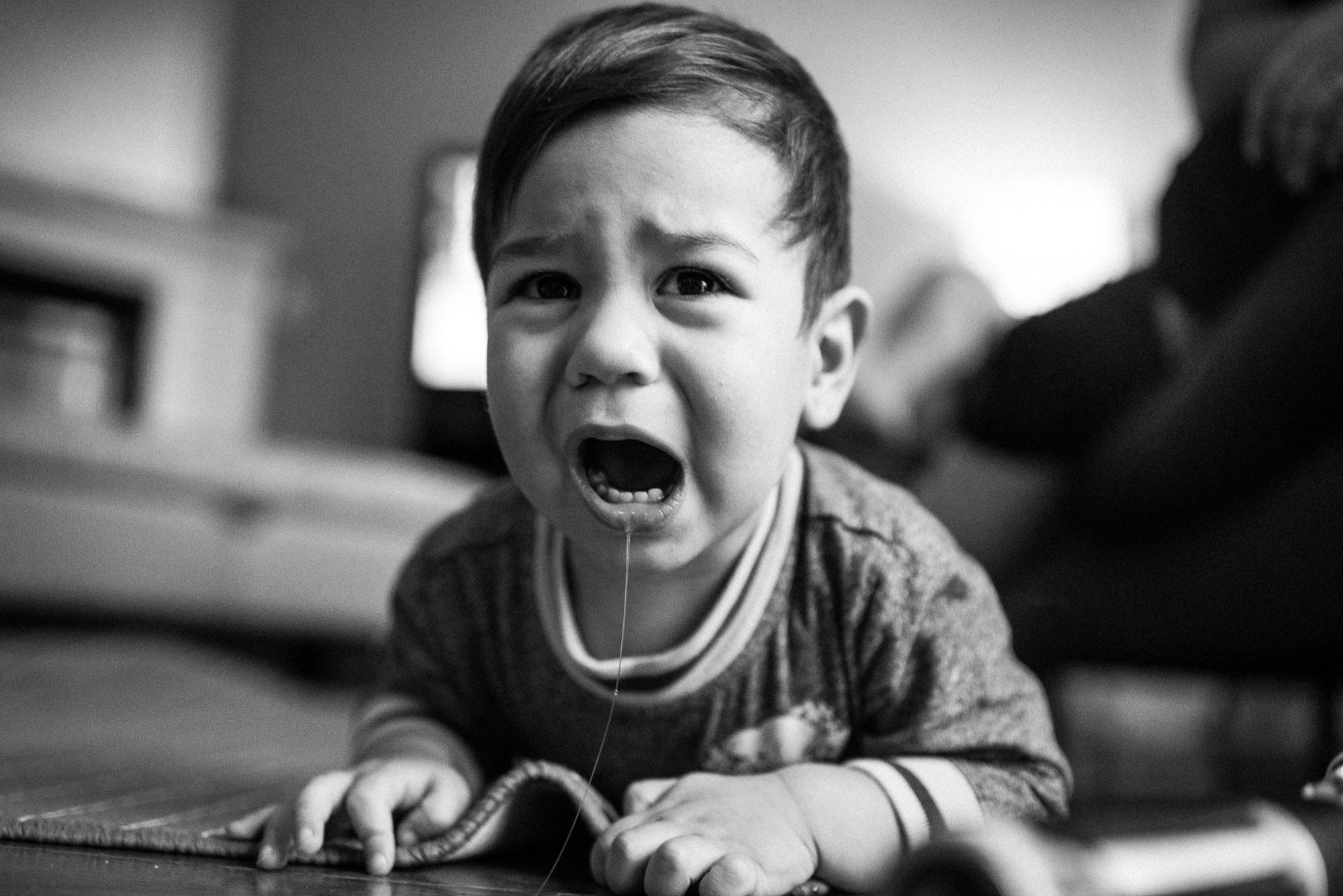 toddler scrunches carpet during a tantrum