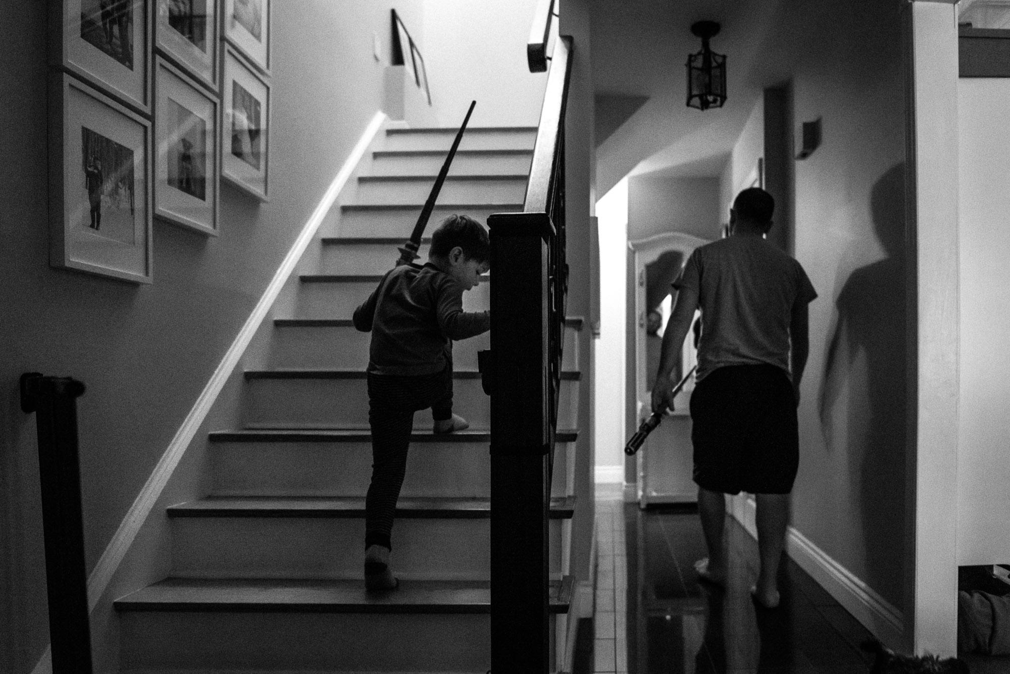 boy climbs the stairs as dad walks away