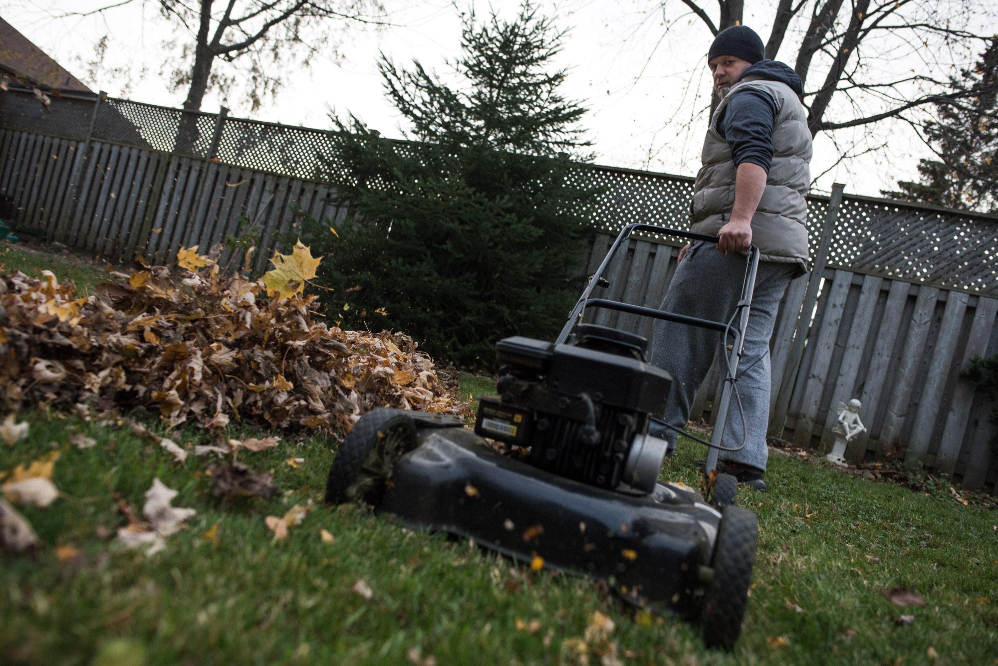 dad pulls on lawnmower