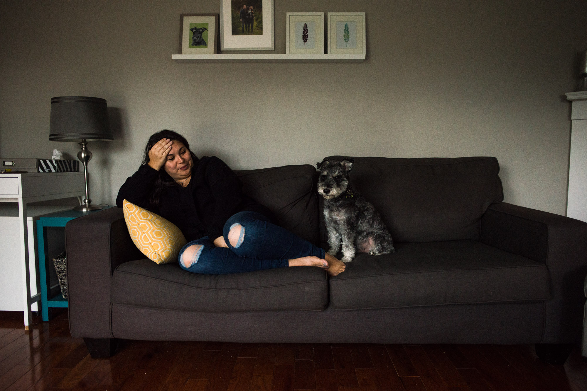 mom enjoys quiet time on the couch with terrier