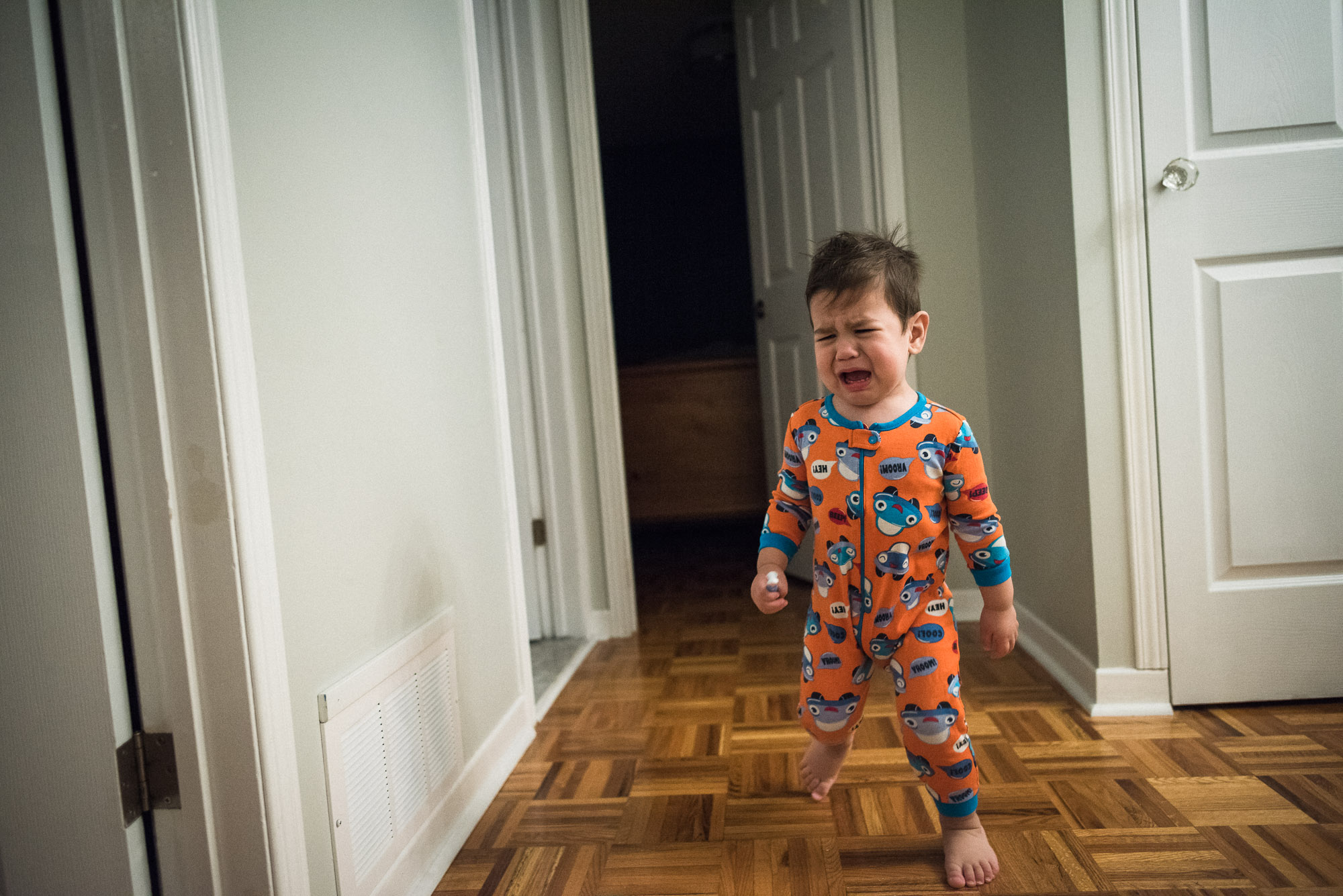 toddler cries down the hallway