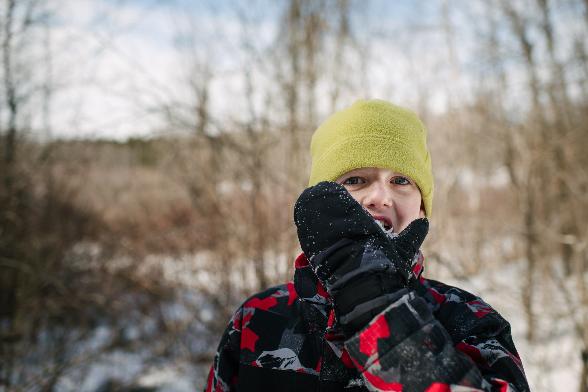 boy licks his winter glove in ontario