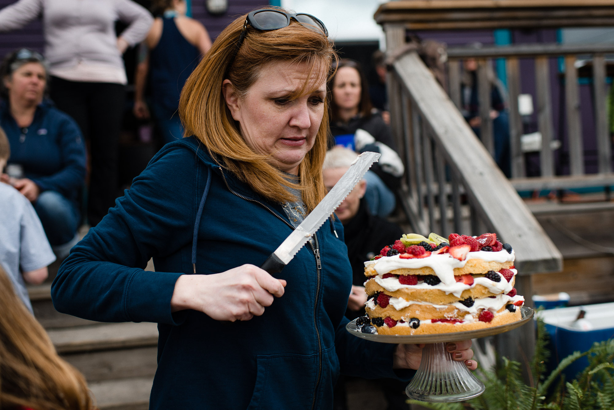 woman carries cake and knife