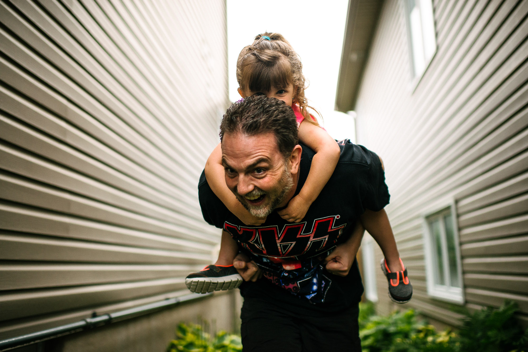 girl rides on her father's back