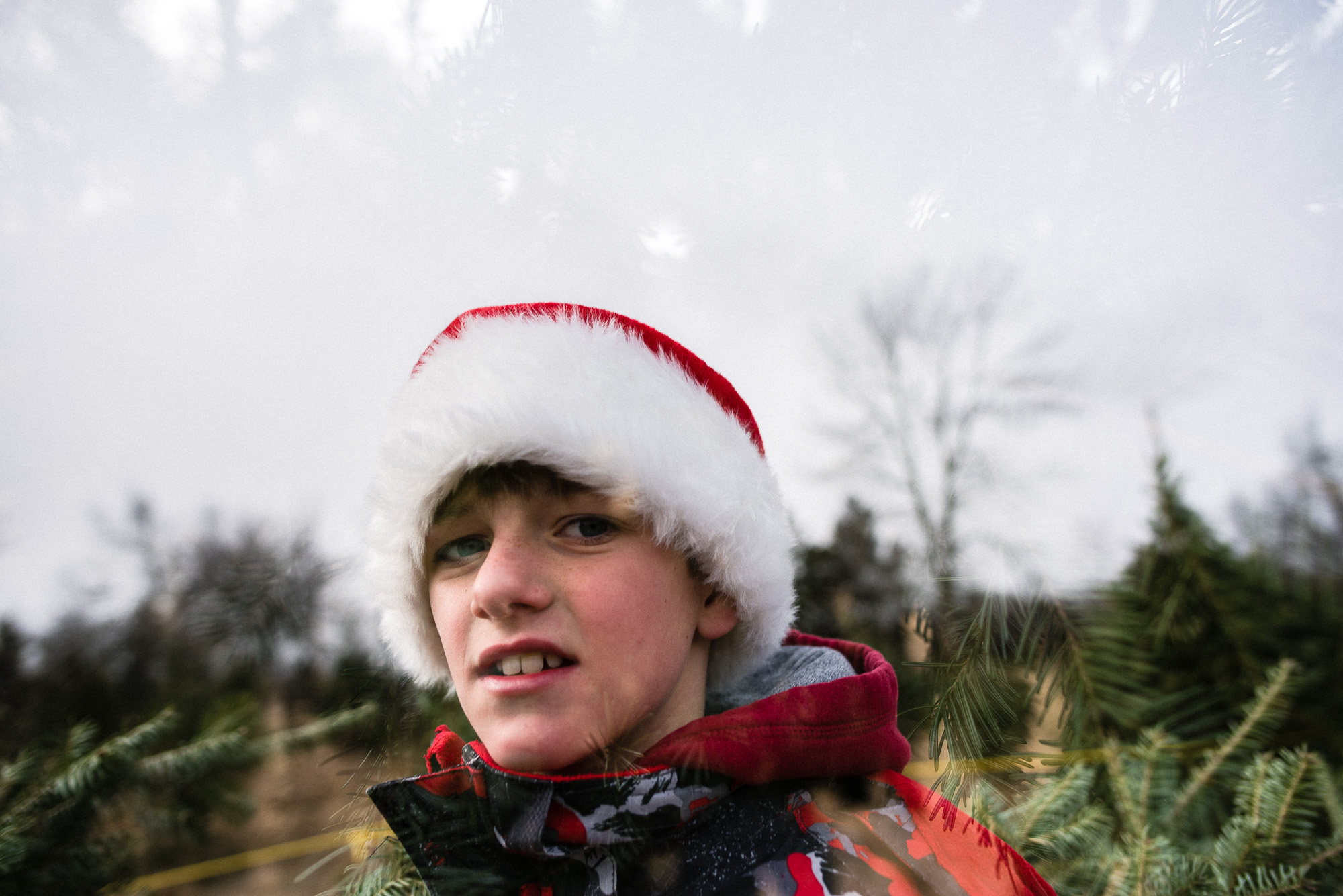 double exposure of a boy in a Santa hat