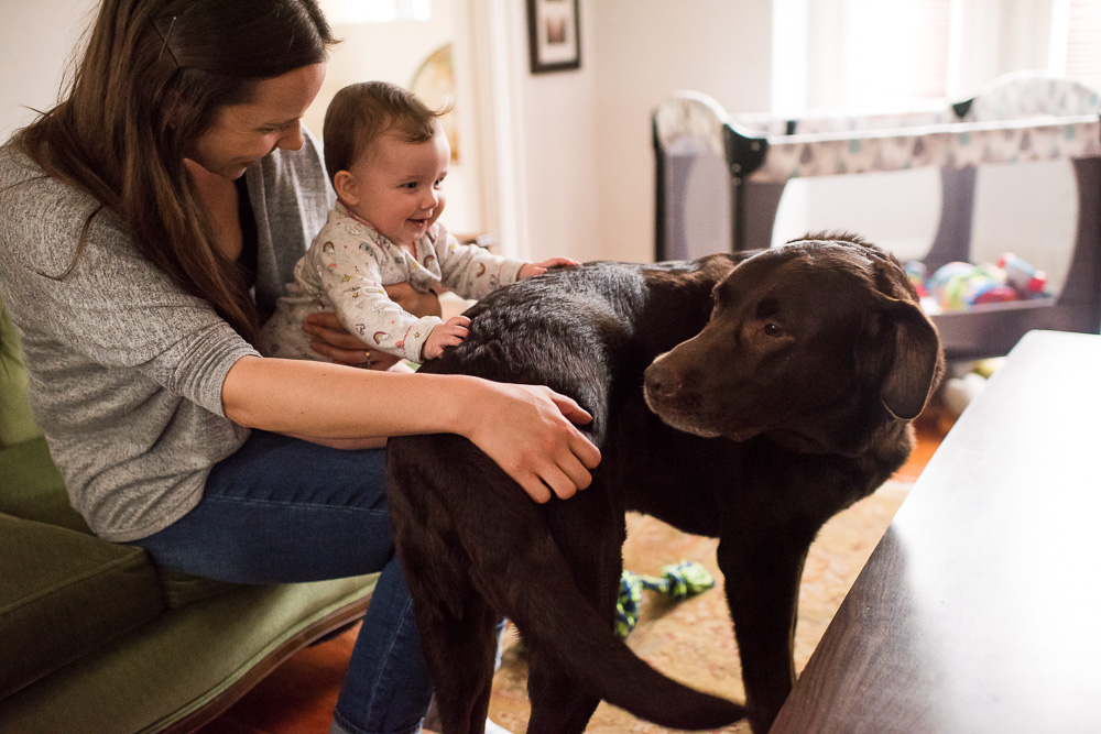 Logan and her daughter play with their dog