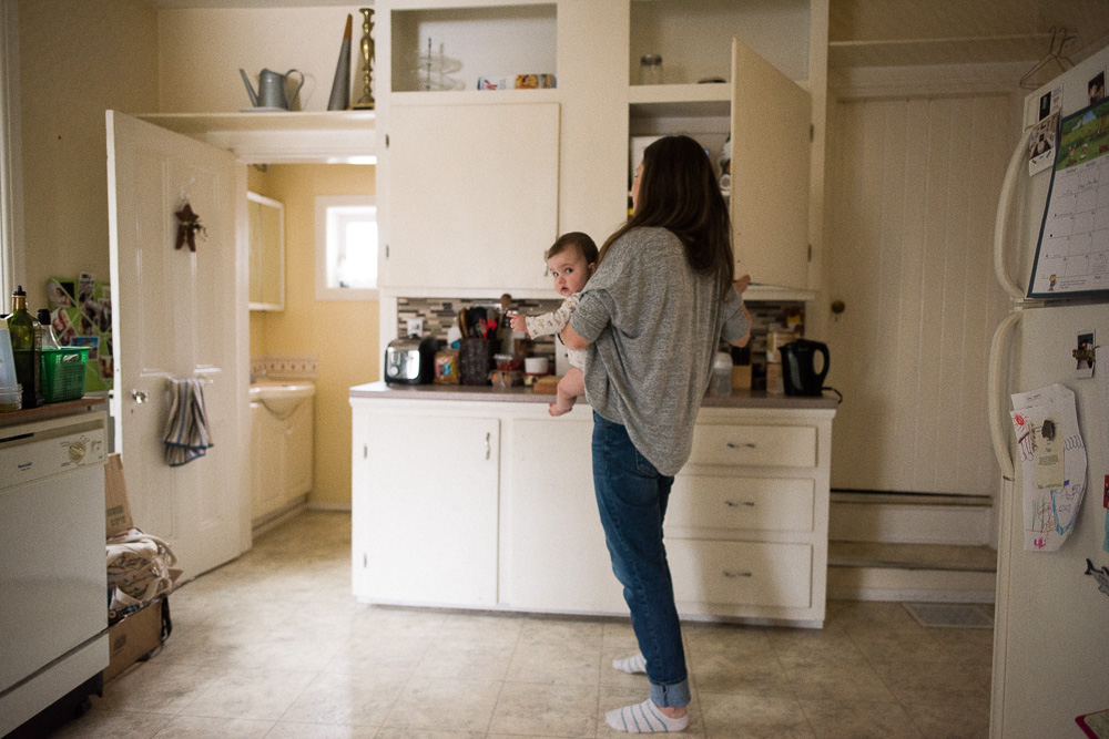 Logan grabs a snack for her daughter at home