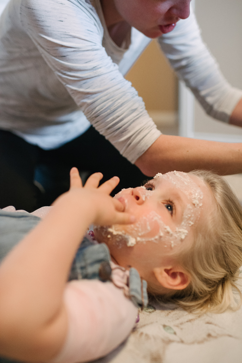Daughter getting face treatment from mother