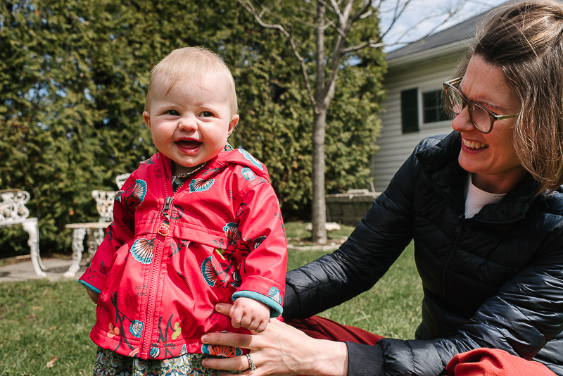 mother and baby smile in the garden during family photography session in ottawa