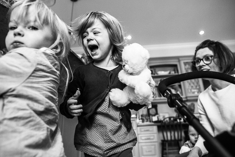 young sisters fight during family documentary photography session