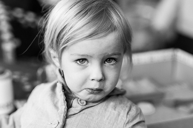 candid portrait in black and white of young girl