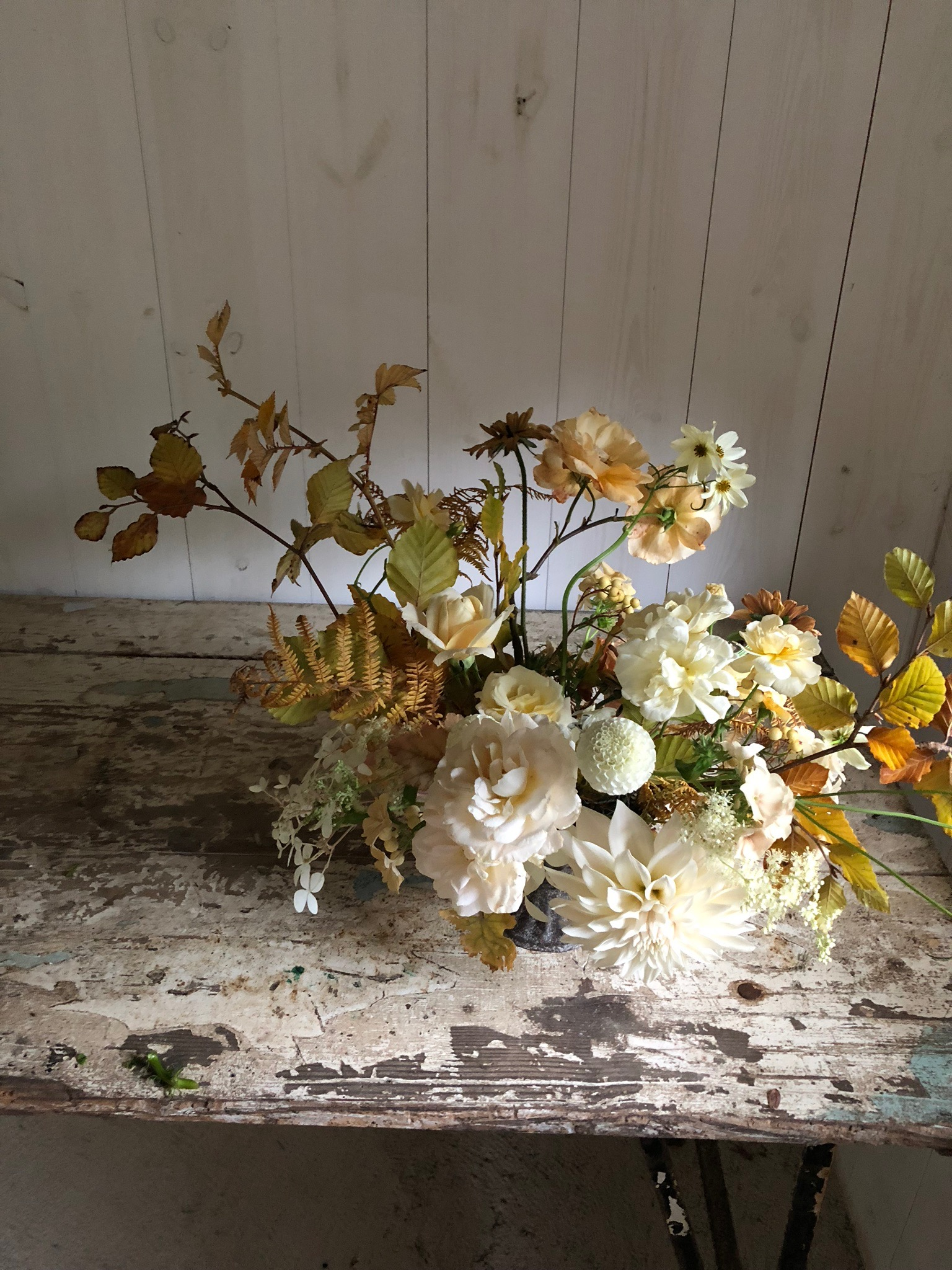 autumn arrangement in creams and beige by The Petaler Floral Co.