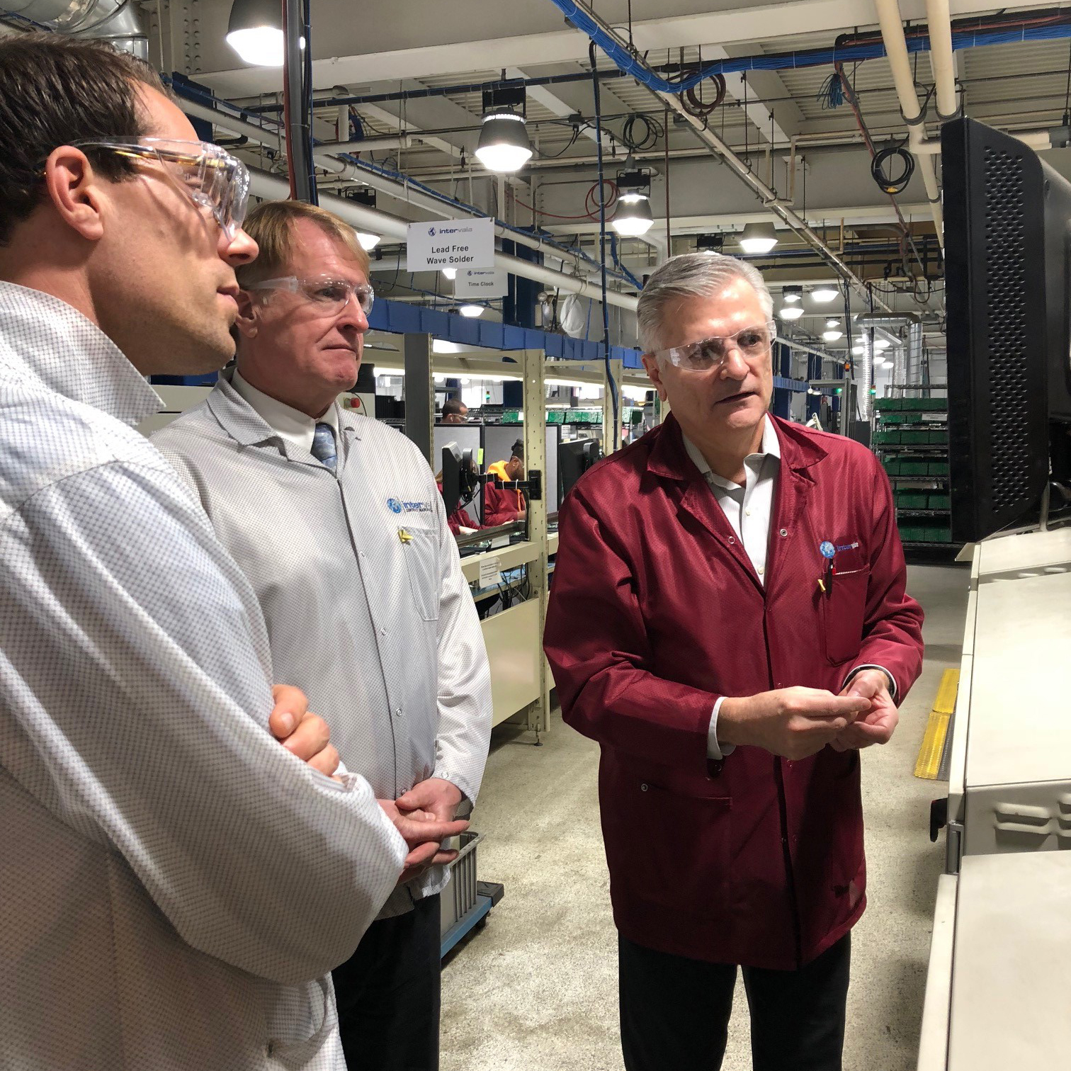 Director of Operations Joe Benz, right, demonstrates the capabilities of Intervala's state-of-the-art surface mount technology lines for Allegheny County Director of Economic Development Lance Chimka, left, and County Executive Rich Fitzgerald.