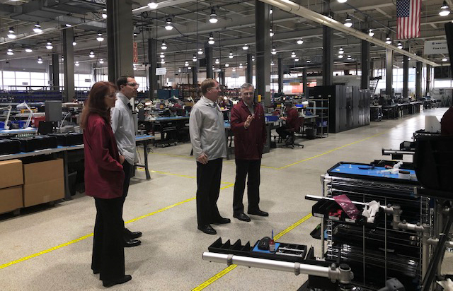 Lance Chimka and Rich Fitzgerald, in white smocks, receive a tour of Intervala's leading-edge manufacturing facility. Here they see the company's extensive electromechanical assembly capabilities.