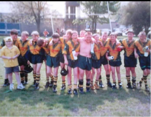 Ben Gunstead (centre) celebrating a cup win over Skirlaugh alongside Olympic Gold Medallist Luke Campbell and other members of West Hull ARLFC