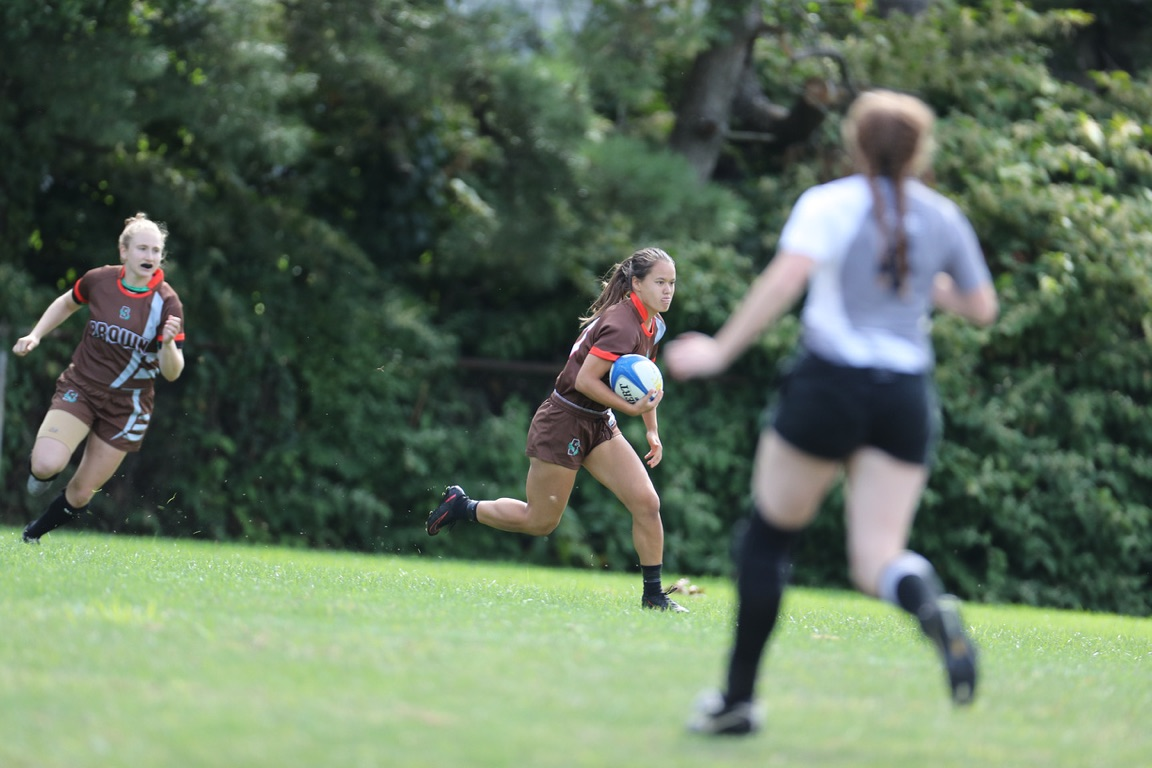 Marion Sellier, making a carry for her team Brown University