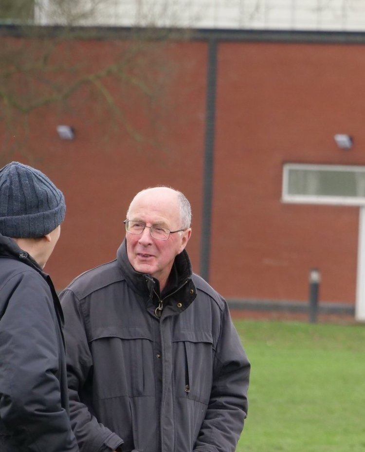 John Mooney (right), can often be found on the touchline of a local amateur rugby game.