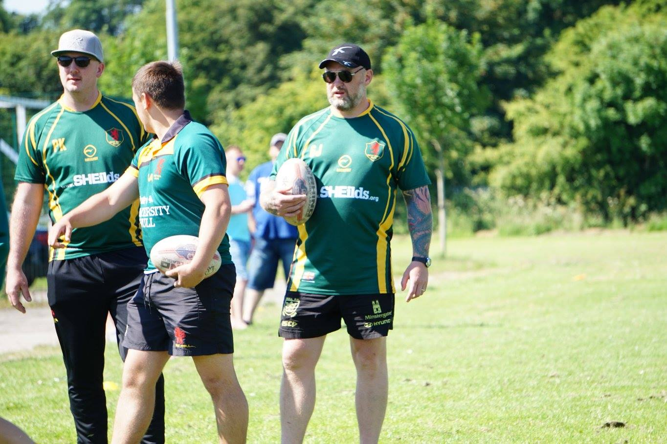 Glyn Jones (right) who also coaches his own son's junior team.