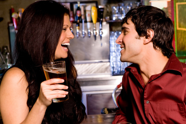 Eligible-woman-flirting-with-guy-in-bar.jpg