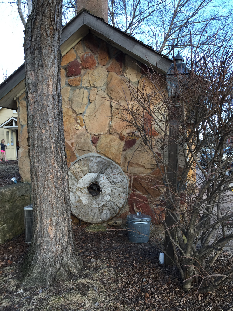 That's one of the original buhr stones from the 1800s Paoli Mill. The air conditioning unit and trash can are not as old.