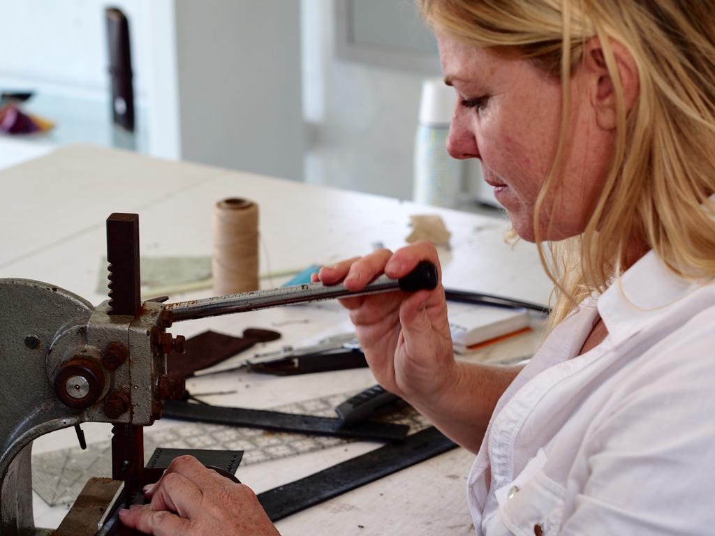 Annalea Mills at work in her leather studio in Antigua