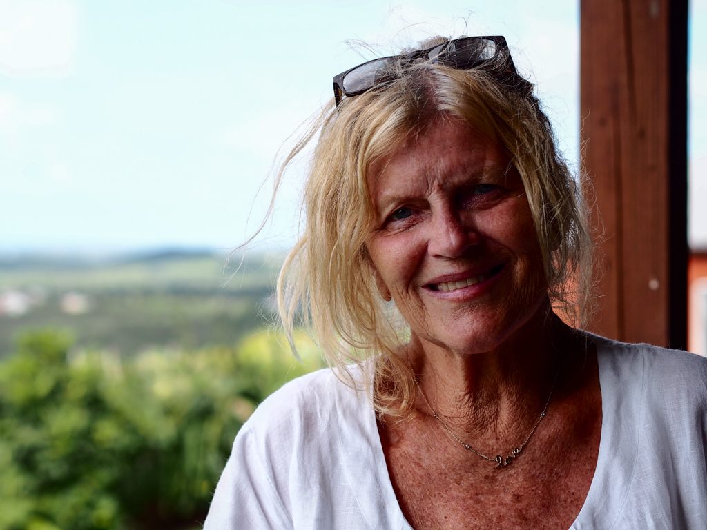 Artist Jan Farara at her home in Antigua with a view across the island. Photo by Jennie Ritchie