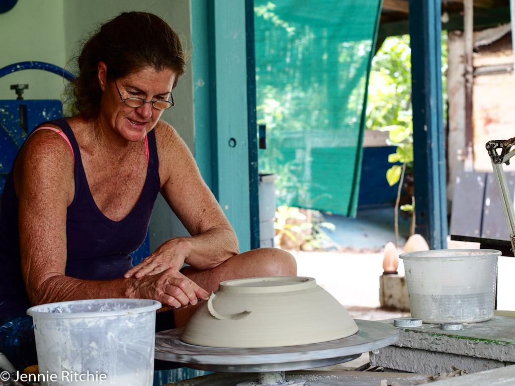 Nancy Nicholson working at her pottery wheel. Photo by Jennie Ritchie.