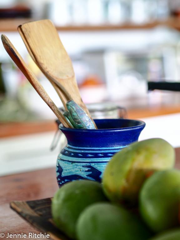 Nancy Nicholson handmade ceramics in her Caribbean home. Photo by Jennie Ritchie.