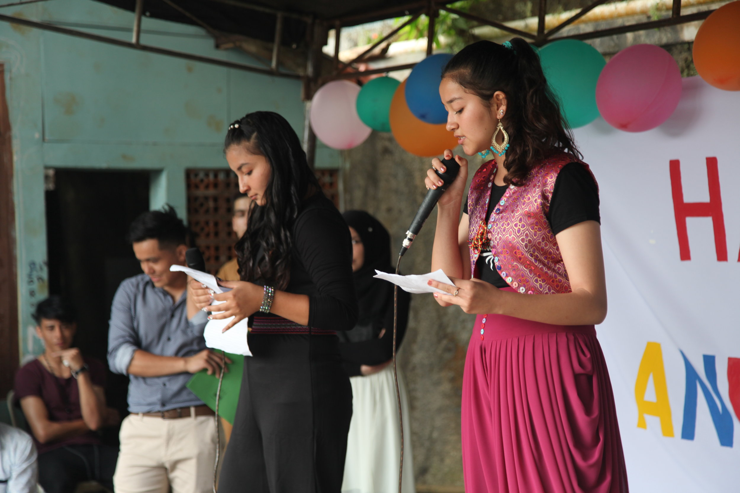 Arzoo and Hania singing national song.JPG