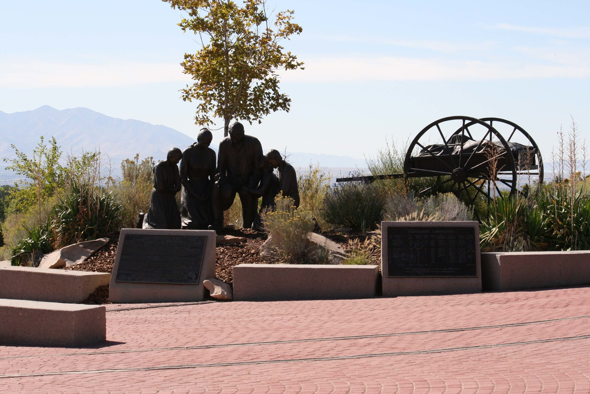 Journey's End Monument - This sculpture depicts a handcart pioneer family kneeling in prayer at the end of their journey. Located at the west end of the Park's pedestrian plaza, the monument was commissioned and donated by L.D. and Mary Bowerman, and sculpted by Stan Watts.