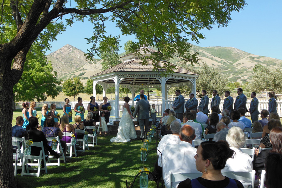 wedding-ceremony-in-the-backyard-of-the-brigham-young-farmhouse.jpg