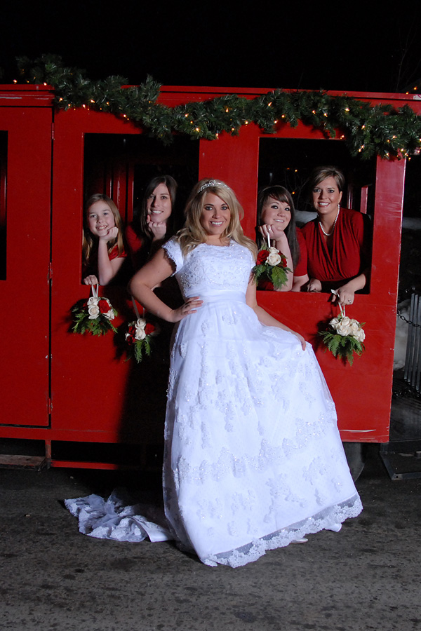 bride-and-bridesmaids-in-front-of-train.jpg
