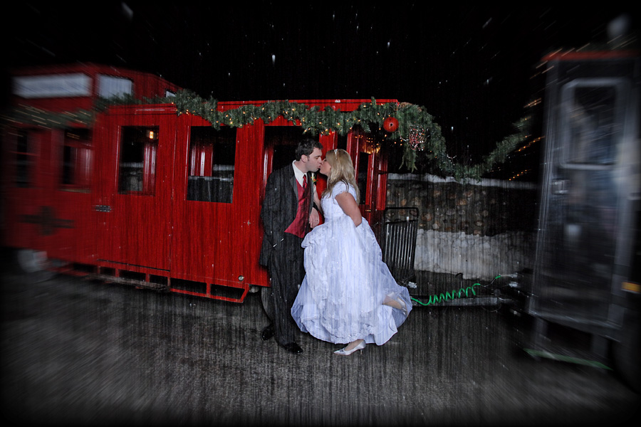 bride-and-groom-kissing-in-front-of-the-train.jpg