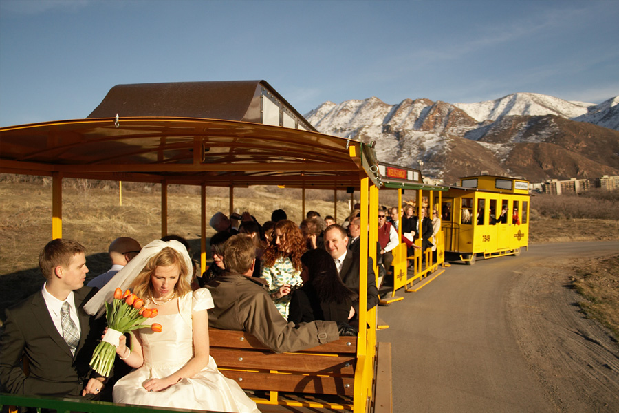 bride-groom-and-guests-taking-a-ride-on-the-train.jpg