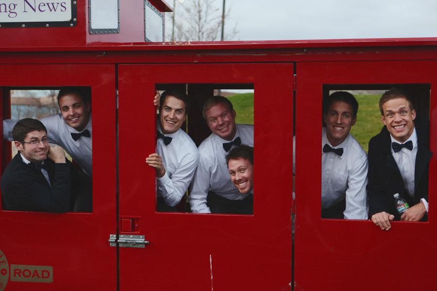 groom-and-groomsmen-inside-train-car.jpg