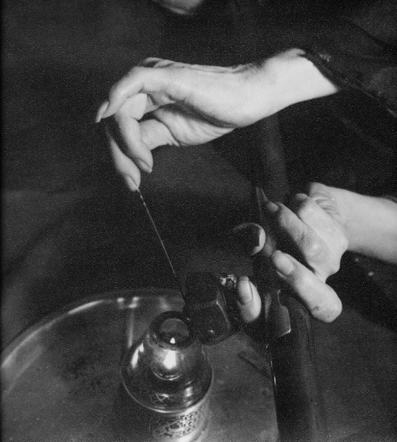 Hedda Hammer Morrisson  – Miserable miracle, preparation of an opium pipe 1, Beijing –  circa 1935  Silverprint – 24 x 25.5 cm – stamped on the back, 'Hedda Hammer, Peking'  This photograph is one of a series of three photographs capturing the steps of the preparation of an opium pipe.