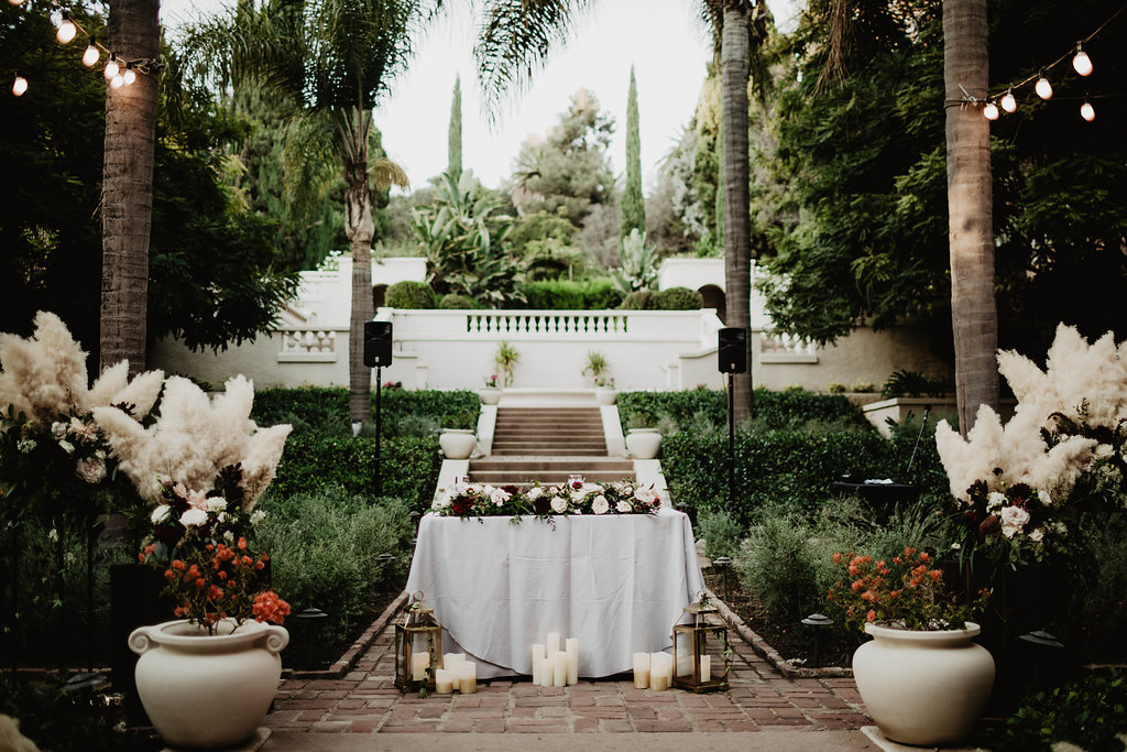 Gorgeous, Moody and Romantic Blush and Burgundy Sweetheart Table for Adrianne, and Joels Hollywood Wedding. Los Angeles California - Royal Bee Florals and Events - Photography by Matt and Jess