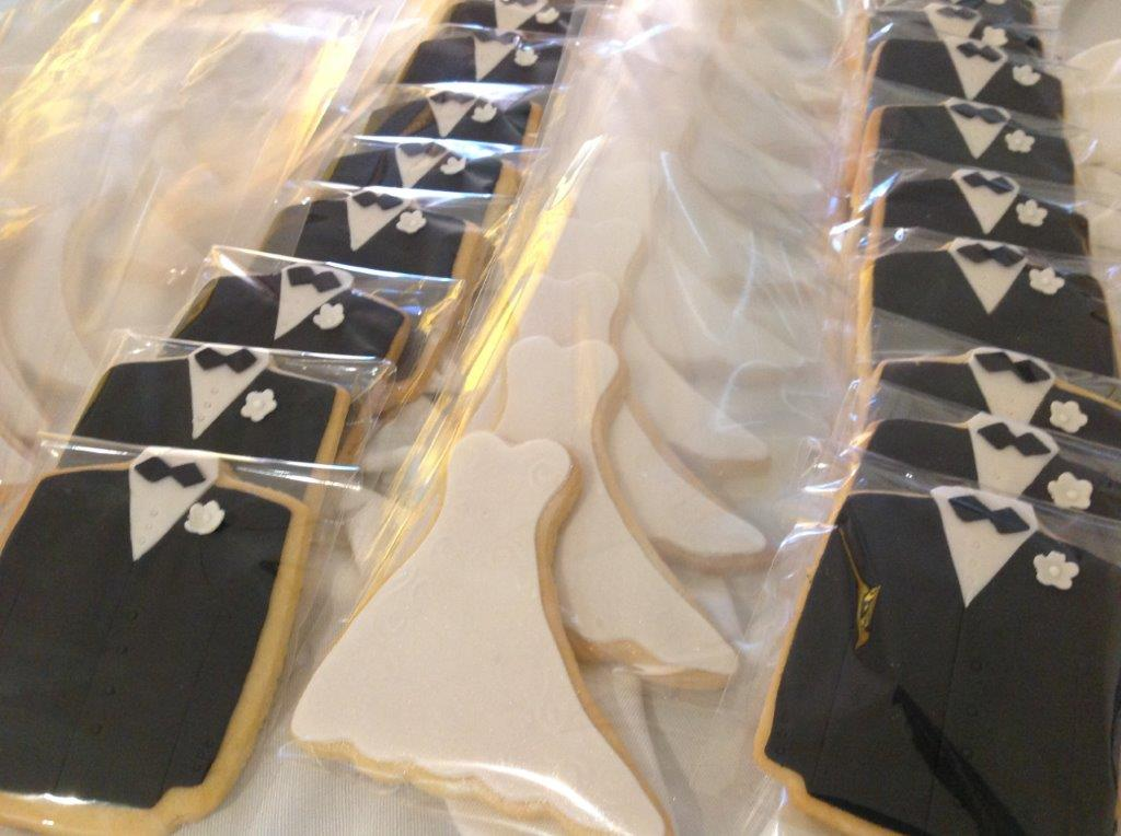 Bride & Groom Butter Cookies iced with fondant. Decorations fully edible! individually wrapped.